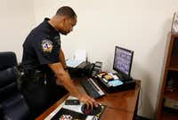 McKinney police officer Bryant Bailey demonstrates the security system at McKinney North High School in McKinney on March 5.(Vernon Bryant/Staff Photographer)