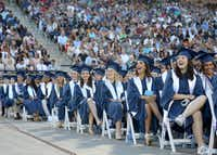 Graduates laugh at images on a big screen during the Allen High School graduation at Eagle Stadium in Allen, Texas, Friday evening, June 1, 2018. (Anja Schlein/Special Contributor)(Anja Schlein/Special Contributor)