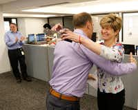 Dallas Morning News editor Mike Wilson hugs 2018 Pulitzer Prize editorial writing finalist Sharon Grigsby during an announcement in <i>The Dallas Morning News</i> newsroom on Monday, April 16, 2018. (Vernon Bryant/Staff Photographer)