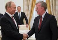Russian President Vladimir Putin (left) shakes hands with U.S. National Security adviser John Bolton during their meeting in the Kremlin in Moscow on June 27.(Alexander Zemlianichenko/AP)