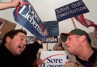 In this file photo from 2000, Al Gore supporter John Paul Sutliff (left) argues with George W. Bush supporter David Hewitt outside of the Supreme Court building Monday, Dec. 11, hours after the court heard oral arguments in the recount case. The court sided with Bush in a 5-4 ruling.(Reza A. Marvashti/The Associated Press)
