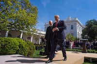 President Donald Trump (right) and Justice Anthony Kennedy make their way back to the Oval Office after administering the oath of office for Justice Neil Gorsuch during a Rose Garden ceremony at the White House on April 10, 2017. (Jabin Botsford/The Washington Post)