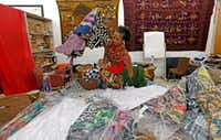 Owner Akwete Tyehimba sorts out dresses in February at Pan-African Connection in Dallas.(Jae S. Lee/Staff Photographer)