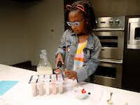 Ellington Young, 7, makes a strawberry and lemonade ice pop.(Vernon Bryant/Staff Photographer)