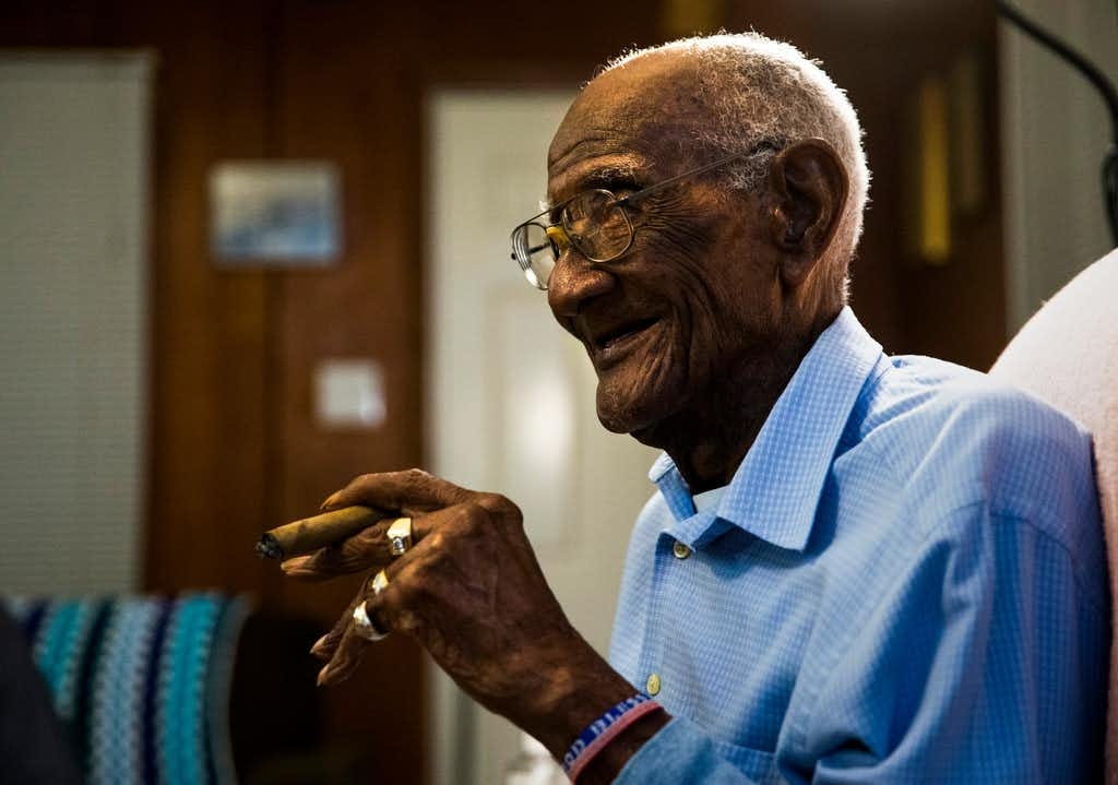 "<p><span style=""font-size: 1em; background-color: transparent;"">U.S. Army veteran Richard Overton, shown just before his 112th birthday, smokes one of his many daily cigars at his Austin home.</span></p>(Ashley Landis/Staff Photographer)"