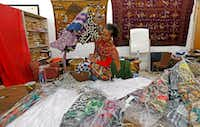 Owner Akwete Tyehimba sorts out dresses at Pan-African Connection in Dallas.(Jae S. Lee/Staff Photographer)