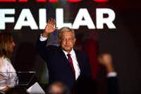 """Newly elected Mexico's President Andres Manuel Lopez Obrador, running for """"Juntos haremos historia"""" party cheers his supporters at a hotel after winning general elections, in Mexico City, on July 1, 2018. / AFP PHOTO / PEDRO PARDOPEDRO PARDO/AFP/Getty Images(PEDRO PARDO/AFP/Getty Images)"""