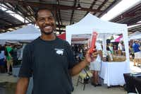 Jason Jackson holds up the frozen wine pops that his family brings to area farmers market along with their Berkshire Farms pork. (Kim Pierce/Special Contributor)