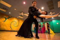 """<p><span style=""""font-size: 1em; background-color: transparent;"""">Julia Alcántara, director of Ida y Vuelta Flamenco, rehearses with her new dance partner, Zyriab Alshafei, for an August performance highlighting the Middle Eastern influences on the Spanish music and dance form. On July 7, her 20-year-old company is producing an international flamenco show in Deep Ellum, """"Bienvenidos! Valeria,"""" headlined by Albuquerque dancer Valeria Montes. with performers from Spain, Venezuela, Cuba and the U.S.</span></p>(Carly Geraci/Staff Photographer)"""