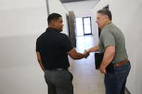 Yodchai Roseborough (left), an insurance specialist with Insurament, shakes hands with Monte Anderson while Roseborough looks for rental space inside DeSoto Market Place in DeSoto. DeSoto Market Place is a retail incubator by Anderson, who is the developer and owner of the property. Anderson wanted authentic and locally made retail to fill the space. Rental spaces are available monthly from $350 to $1,400(Andy Jacobsohn/Staff Photographer)