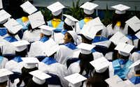 Graduates look for their parents in the audience during the Wilmer-Hutchins High School graduation in June.(Nathan Hunsinger/Staff Photographer)