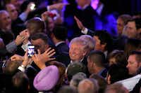 President-elect Donald Trump shakes hands with supporters after making his acceptance speech at an election party at the Midtown Hilton in New York City early on Nov. 9, 2016.(Tom Fox/Staff Photographer)