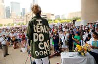 """Actress and activist Cheryl Allison wore a """"I Really DO Care, Don't U"""" green jacket as she spoke during the Keep Families Together rally  at Dallas City Hall on June 30, 2018. The jacket mocks the one first lady Melania Trump wore, which said the opposite. The rally and march was part of a nationwide effort  protesting President Donald Trump's zero-tolerance border policy.(Tom Fox/Staff Photographer)"""