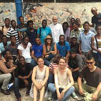 """Fashion designer Donna Karan (middle) with artisans and students in Haiti. Karan's Urban Zen Foundation is participating in this year's new """"Wear Your Impact"""" initiative at the 2018 International Folk Art Market in Santa Fe.(Donna Karan New York)"""