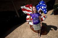 Sheri Hall poses for a portrait in front of a Pegasus sculpture at the Preston Valley Shopping Center in Dallas on July 5, 2018. Hall submitted a question to Curious Texas after noticing the sculptures disappear around the city.(Carly Geraci/Staff Photographer)