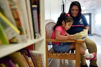 Patricia Vega works with her daughter Elizabeth Diaz on educational activities to help her before she enters pre-K at the Bachman Lake Together Family Center in Dallas. (Ben Torres/Special Contributor)(Ben Torres/Special Contributor)