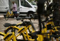 Maurice Clark said he feels a sense of pride when he sees cyclists whiz by on Ofo bikes. He keeps cards in his wallet with a code for free Ofo rides. (Andy Jacobsohn/The Dallas Morning News)(Andy Jacobsohn/Staff Photographer)