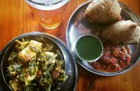 Saag paneer, lamb samosas and a local brew hit the spot at Bollywood Theater PDX.(Marc Ramirez/Staff)