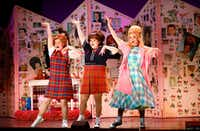 Taylor O'Toole playing Penny Pingleton (left), Michelle Dowdy as Tracy Turnblad and Deanna Ott as Amber Von Tussle perform a scene during final dress rehearsal of <i>Hairspray</i>, produced by Dallas Theater Center at the Winspear Opera House in Dallas.  (Tom Fox/Staff Photographer)