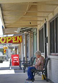 Resident Mary Beyer takes a smoke break in downtown Rockdale, Texas, Thursday, June 14, 2018. (Jae S. Lee/Staff Photographer)