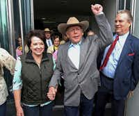 """Cliven Bundy walks out of federal court with his wife, Carol, in Las Vegas in January. Attorney Bret Whipple on Friday, July 6, 2018, characterized his 72-year-old client as relieved following Chief U.S. District Judge Gloria Navarro's ruling this week that prosecutors' """"flagrant misconduct' irreparably tainted the case.(K.M. Cannon/The Associated Press)"""