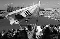 June 17, 1994: A fan waves a South Korean  flag before the start of the first World Cup game in Dallas between South Korea and Spain.(IRWIN THOMPSON/DMN)