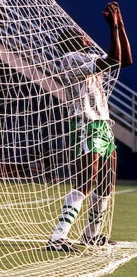 6/21/94 -- Nigeria's forward Rashidi Yekini celebrates in the net after scoring Nigeria's first goal of their game against Bulgaria during their World Cup Soccer Championship Group D first round World Cup match at the Cotton Bowl in Dallas, on Tuesday, June 21, 1994.(IRWIN THOMPSON/DMN)