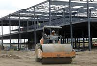 Work is progressing on the construction at Grandscape near Nebraska Furniture Mart in The Colony.(Jason Janik/Special Contributor)