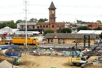 A railroad maintenance train passes the historic Grapevine train depot in downtown Grapevine.  Development around the TexRail commuter line connecting downtown Fort Worth with Grapevine and DFW Airport includes the 121-room Hotel Vin and 552-space parking garage. (Tom Fox/Staff Photographer)