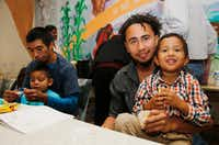 Roger Ardino, 24, (right) and his son Roger Ardino Jr., 4, pose for a photo as they and Pablo Ortiz, 28, left, and his son Andres, 3, spoke to the media during a news conference at the Annunciation House in El Paso.(Ruben R. Ramirez/El Paso)