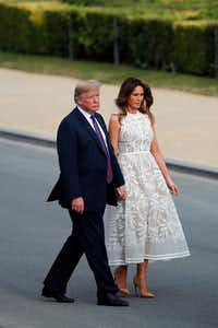 President Donald Trump and U.S. first lady Melania Trump walk after a group photo of NATO heads of state and government at Park Cinquantenaire in Brussels.(Francois Mori/AP)