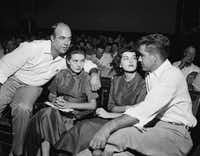 "In this Sept. 23, 1955, file photo, J.W. Milam (left), his wife (second left), Roy Bryant (far right) and his wife, Carolyn Bryant, sit together in a courtroom in Sumner, Miss. Bryant and his half-brother Milam were charged with murder but acquitted in the kidnap-torture slaying of 14-year-old black teen Emmett Till in 1955 after he allegedly whistled at Carolyn Bryant. The men later confessed in a magazine interview but weren't retried; both are now dead. Citing ""new information,"" the U.S. Justice Department has reopened the investigation into Till's death. (AP Photo, File)(AP)"