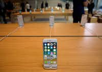 Watching an iPhone die a premature death is distressing and costly, Watchdog Dave Lieber says.(Kiichiro Sato/The Associated Press)