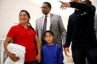 Darwin Micheal Mejia, bottom center, and his mother, Beata Mariana de Jesus Mejia-Mejia, left, are escorted to a news conference following their reunion at Baltimore-Washington International Thurgood Marshall Airport, Friday, June 22, 2018, in Linthicum, Md. The Justice Department agreed to release Mejia-Mejia's son after she sued the U.S. government in order to be reunited following their separation at the U.S. border. She has filed for political asylum in the U.S. following a trek from Guatemala. (Patrick Semansky/The Associated Press )