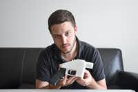 Cody Wilson with a 3-D printed gun(Lorenza Baroncelli/Defense Distributed)