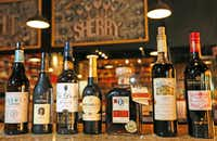 A selection of wines available at the Tapas Castile restaurant in Trinity Groves.(Louis DeLuca/Staff Photographer)