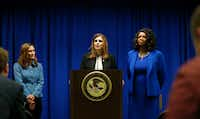 U.S. Attorney Erin Nealy Cox, center, holds a news conference on Friday, July 13, 2018 in Dallas.  Federal prosecutors say eight MS-13 members have been indicted in Texas on charges tied to alleged gang activities including racketeering conspiracy, attempted murder and assault. (Vernon Bryant/The Dallas Morning News)(Vernon Bryant)