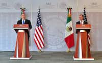 U.S. Secretary of State Mike Pompeo (left) and Mexico's Foreign Minister Luis Videgaray speak to the media at the Foreign Ministry in Mexico City on July 13, 2018.(Pedro Pardo/Agence France-Presse)