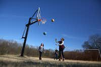 <p>Kelly Blake (far right) played basketball with her sister Keaton Blake and brother Landon Blake at their home in McKinney.  An early study to build a bypass north of U.S. Highway 380 showed a freeway possibly cutting through their property.</p>(Rose Baca/Staff Photographer)
