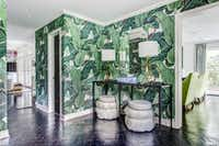 Go for Hollywood glam with Martinique's jungle palm wallpaper that the Beverly Hills Hotel made famous. Emily Johnston Larkin of EJ Interiors recently used the iconic print in a Dallas entryway.(EJ Interiors)
