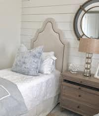 Natural fabrics and fibers create a tranquil and casual feel in this beach house guest room designed by Emily Sheehan Hewett and A Well Dressed Home.(A Well Dressed Home)