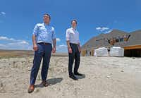 Developers Tony Ruggeri, left, and Jake Wagner, of the Republic Property Group, pose for a photograph on one of lots next to homes that are in construction at the Walsh development in Fort Worth, Texas, Thursday, July 5, 2018. The Walsh development, formerly part of Walsh Ranch, is on more than 7,000 acres. (Jae S. Lee/The Dallas Morning News)(Jae S. Lee/Staff Photographer)