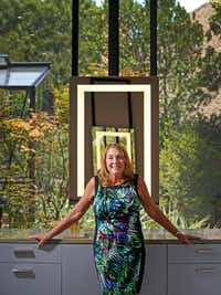 Homeowner Lynn Rush poses for a photograph in front of a mirror with a LED light in the master bathroom at her LEED Platinum-certified home in Addison, Texas, Wednesday, July 11, 2018.(Jae S. Lee/Staff Photographer)