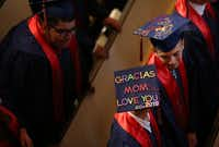 A graduate adorned his mortarboard with a message to his mother during a commencement ceremony for Uplift Peak Preparatory graduates at Park Cities Baptist Church in Dallas on May 25, 2018. (Rose Baca/Staff Photographer)