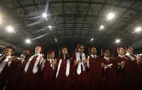 Graduates sing the school song during Plano Senior High School's graduation ceremony at The Ford Center at The Star in Frisco on June 10, 2017.(Jason Janik/Special Contributor)