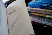 A signed copy of <i>All Your Perfects </i>by Colleen Hoover at her bookstore  in Sulphur Springs, Texas.  (Nathan Hunsinger/Staff Photographer)