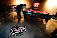 The pool table at The Pretty Diver bar on Ross Avenue near downtown Dallas is gone after a settlement with the city. (Tom Fox/Staff Photographer)