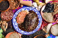 "Mole poblano is a specialty dish of Pueblo. The term ""mole"" means sauce, and the complex sauces contain up to two dozen ingredients.(Ministry of Culture and Tourism of the State of Puebla, Mexico/ )"