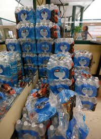 Bottles of water are stacked high in a cooling center at Reverchon Recreation Center in Dallas on July 19.(Jae S. Lee/Staff Photographer)