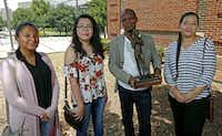Artist Emmanuel Gillespie with the maquette of the statue and three of the students who have worked with him -- from left, Bella Najera,  Jennifer Huynh and Natalie Carvajal -- at Booker T. Washington High School, where the statue of Ernie Banks will be placed. (Jae S. Lee/Staff Photographer)